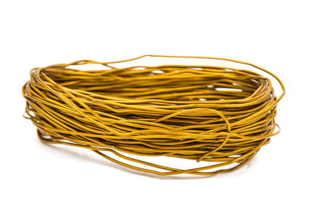 conductivity: a coil of copper wire isolated on white background