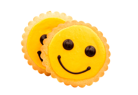 smilie: Yellow Smiley biscuits on a white background.