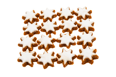star shaped: Christmas star shaped cookie with white icing isolated on white
