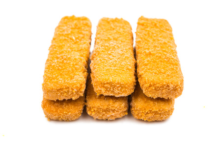 crumbing: some fish sticks on a white background