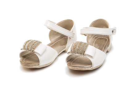 nostalgy: old baby shoes isolated on white background Stock Photo
