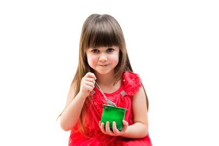 eating yogurt: girl eating yogurt on a white background Stock Photo