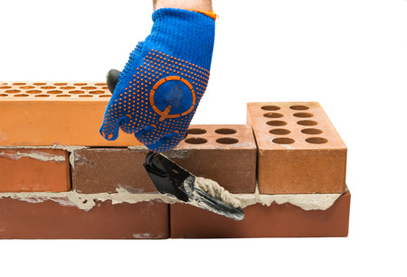 bricks on a white background with construction accessories