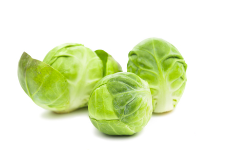 sprout: a pile of Brussels sprouts on a white background