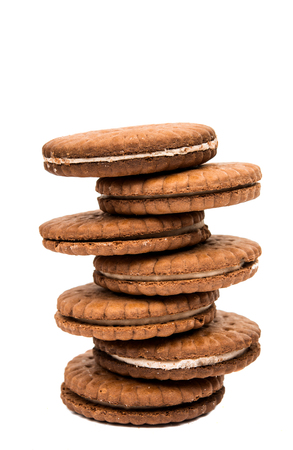 chocolate biscuit: sandwich cookies isolated on white background Stock Photo