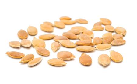 salted: pumpkin seeds isolated on white background