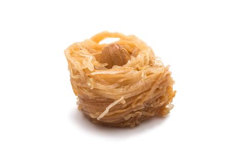 baklawa: baklava with walnuts on a white background