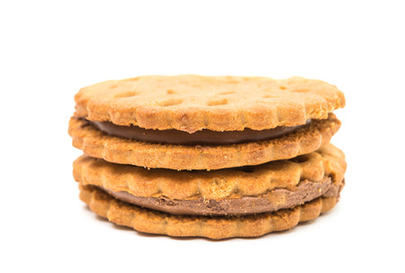 biscuts: Sandwich cookies with chocolate cream on a white background Stock Photo