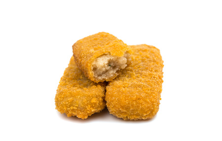 some fish sticks on a white background