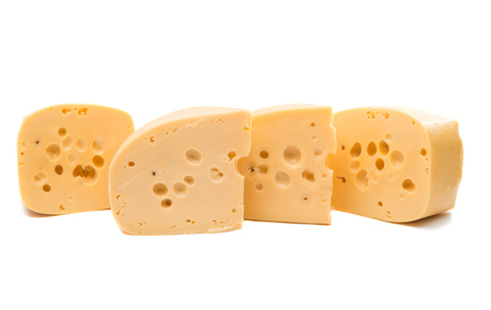 cheez: a large piece of cheese on white background