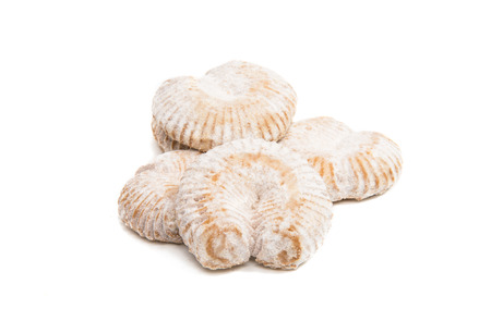 Cookies in powdered sugar on a white background