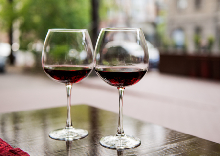 Two glasses with red wine in a cafe