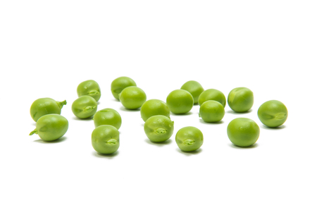 pea pod: Green peas on a white background