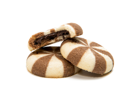 Striped cookies with chocolate filling on a white background