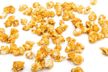 molasses: Caramelized popcorn isolated on white background Stock Photo