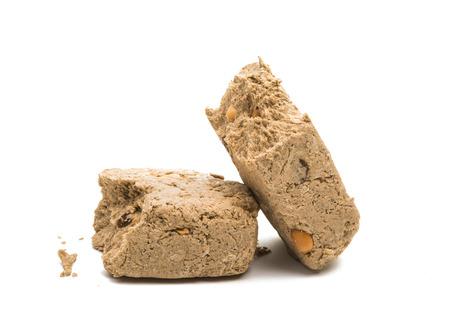 Piece of peanut halva isolated on white background Stock Photo