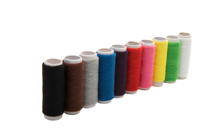set of colored threads isolated on white background