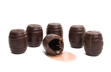 chocolate barrels with liquor isolated on white background