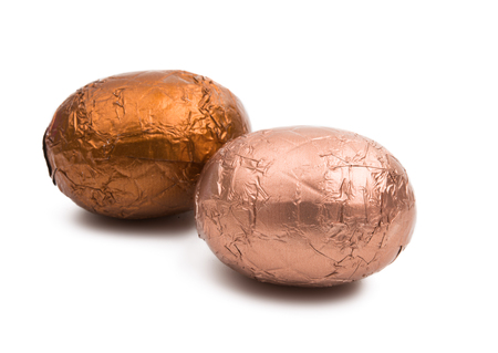 chocolate eggs in foil isolated on white background Reklamní fotografie