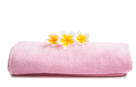 frangipani on a pink towel isolated on white background
