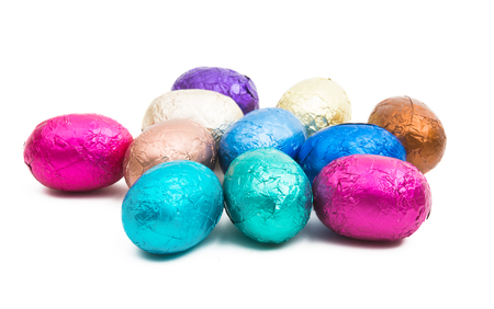 chocolate eggs in color foil isolated on white background