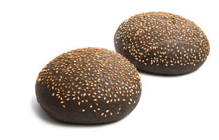 black hamburger bun isolated on white background Reklamní fotografie