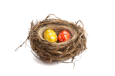 chocolate eggs in a nest isolated on white background Stock Photo
