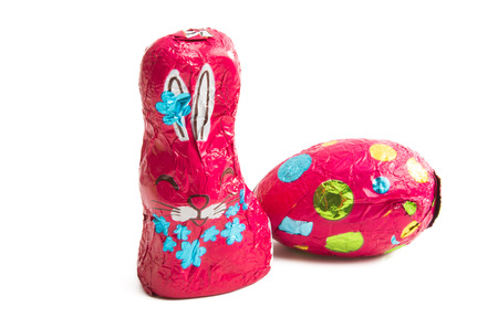 chocolate bunny in foil isolated on white background