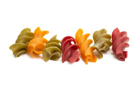 colored italian pasta isolated on white background