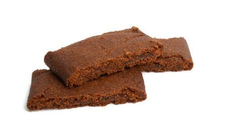 chocolate sponge cake isolated on white background Imagens