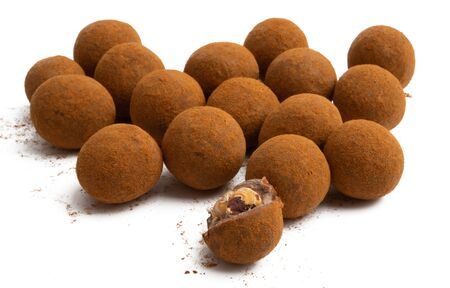 chocolate truffles with nuts isolated on white background
