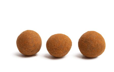 chocolate truffles with nuts isolated on white background Banque d'images
