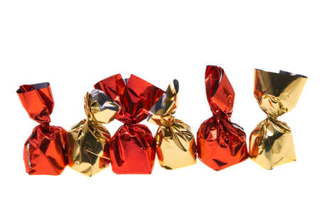 chocolate candies in wrapper isolated on white background Zdjęcie Seryjne
