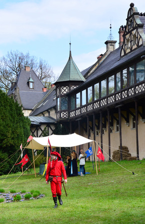 Kliczkow Castle, Boleslawiec, Poland, May 1, 2017 - The castle buildings on the day of the Knight Tournaments. People are in historical costumes