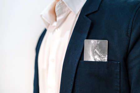 Bank or credit card in the pocket of a blue men's jacket 版權商用圖片
