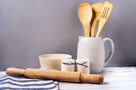 Harmonious background, the concept of the cozy kitchen. Kitchen utensils on a uniform background Stok Fotoğraf