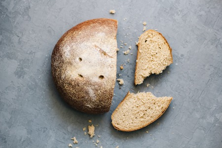 warm, freshly rye bread. Cut the slices. Tear off a piece. top view. Farm food made from flour and eggs.