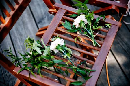 wedding flowers on chair for guests