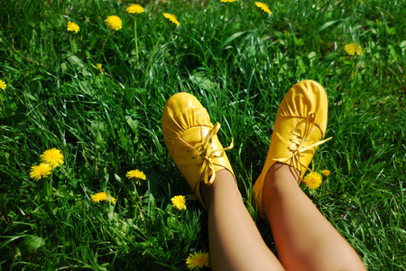 Yellow boots on a fresh green grass