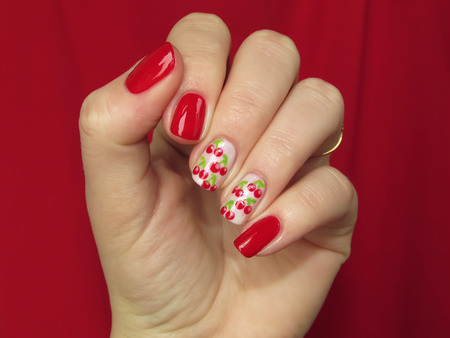 nailart: red manicure with cherries Stock Photo
