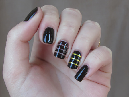 nailart: brown manicure with gold ribbons