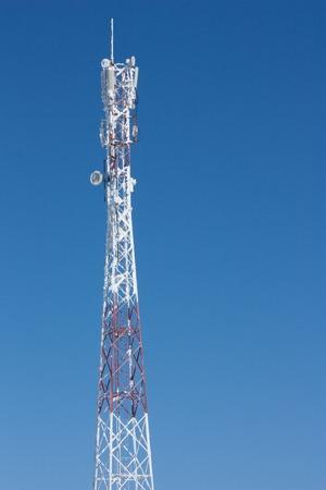 通信: Communications tower. use a smart phone 写真素材