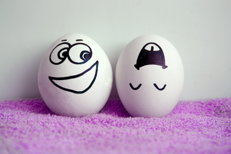 asian family: Eggs are cheerful with a face. Two pieces. Concept of naughty. Photo for your design Stock Photo