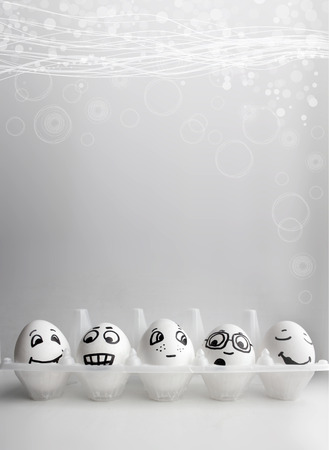Eggs with funny painted faces. A photo with a place under the text for your design