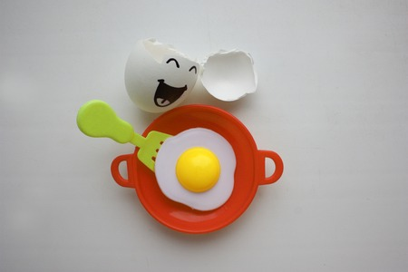 Eggs with face. Concept of unrestrained Stock Photo
