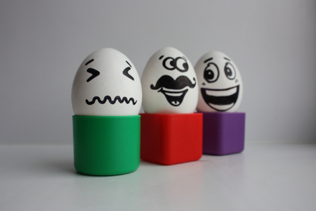 shaken: Eggs with a cute face. Photo for your design. Concept: gossip behind your back is shaken Stock Photo