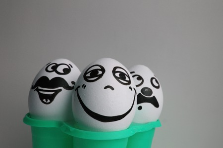 Eggs with a cute face. Photo for your design. three eggs. Concept: mustache and smile