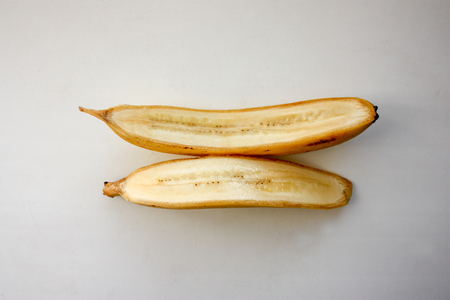A banana in a cut on a white background. Delicious and appetizing. Photo for your design