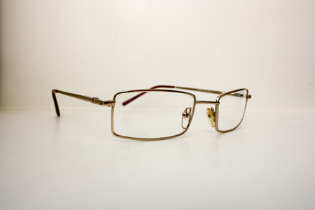 Glasses to lie. The concept of learning and business. on a white background. Photo for your design Stock Photo