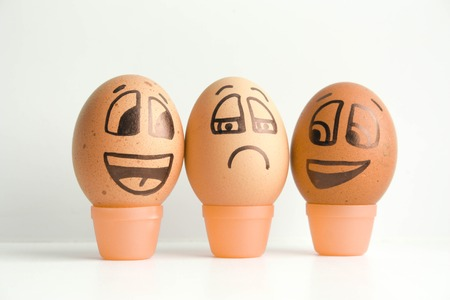 Cheerful eggs. The concept of discontent, bombast. Photo for design. Eggs with painted face. Horizontal orientation of the sheet.